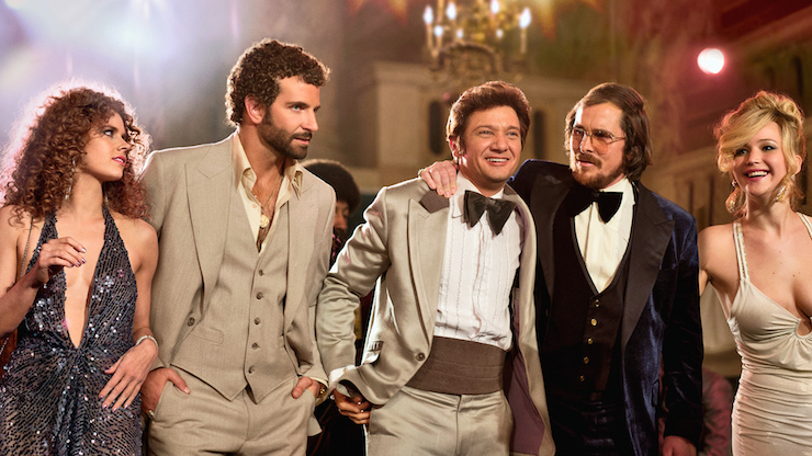 Adams (far left) and Lawrence (far right) earned less than their male co-stars for 'American Hustle'.