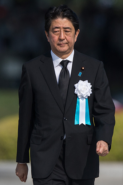 HIROSHIMA, JAPAN - AUGUST 06: Japanese Prime Minister Shinzo Abe walks to give a speech during the 70th anniversary ceremony of the atomic bombing of Hiroshima at the Hiroshima Peace Memorial Park on August 6, 2015 in Hiroshima, Japan. Japan marks the 70th anniversary of the first atomic bomb that was dropped by the United States on Hiroshima on August 6, 1945. The bomb instantly killed an estimated 70,000 people and thousands more in coming years from radiation effects. Three days later the United States dropped a second atomic bomb on Nagasaki which ended World War II. (Photo by Chris McGrath/Getty Images)
