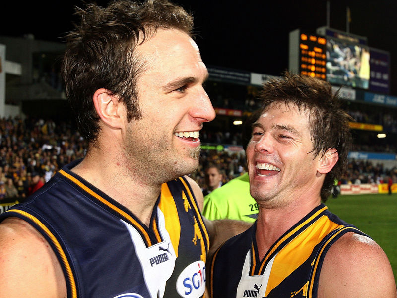 Judd and Cousins celebrate a round 15 win in 2006.