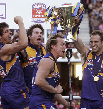 Andrew Embley, Cousins, Daniel Chick Chris Judd celebrate their 2006 Grand Final win against Sydney.