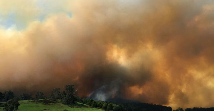 Plumes of smoke rise near Lancefield, in central Victoria.