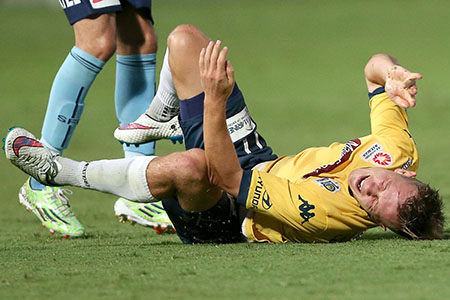 GOSFORD, AUSTRALIA - JANUARY 24: Nick Fitzgerald of the Maqriners screams in pain during the round 16 A-League match between the Central Coast Mariners and Sydney FC at Central Coast Stadium on January 24, 2015 in Gosford, Australia. (Photo by Tony Feder/Getty Images)