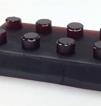 A block of the sulfur-limonene polysulfide: a polymer synthesised entirely from industrial by-products.