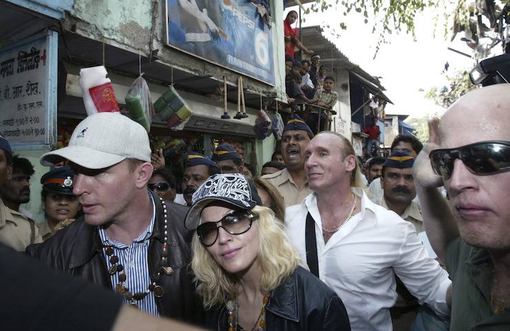 Roberts (right) escorting Madonna and Guy Ritchie through Mumbai in 2008. Photo: AAP
