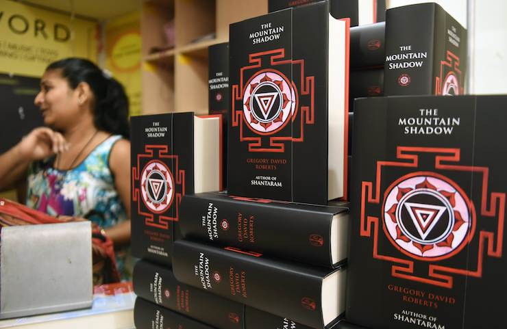 """Copies of Gregory David Roberts new book """"The Mountain Shadow"""" at a book store in Mumbai on October 13, 2015. Photo: AAP"""