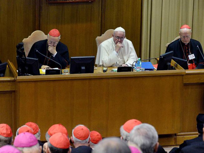Pope Francis prays during the synod.