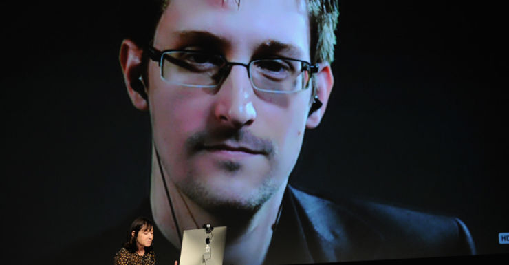 Mr Snowden is interviewed via video link at the New Yorker Festival in 2014.