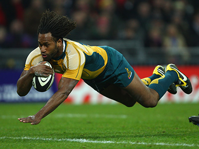 LONDON - DECEMBER 03: Lote Tuqiri of Australia dives over for the first try of the match during the 1908 - 2008 London Olympic Centenary match between The Barbarians and Australia at Wembley Stadium on December 3, 2008 in London, England. (Photo by Mike Hewitt/Getty Images) *** Local Caption *** Lote Tuqiri