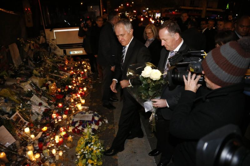 Malcolm Turnbull and New Zealand's president John P. Key laid flowers at a memorial for the victims of Paris' terrorist attacks in front of the Bataclan.