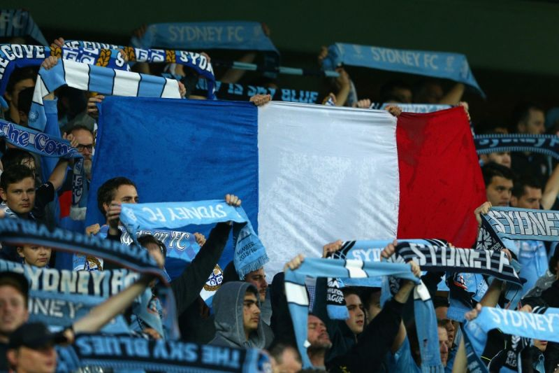 Sydney FC fans display the French flag at the A-League game against Melbourne victory. Photo: Getty