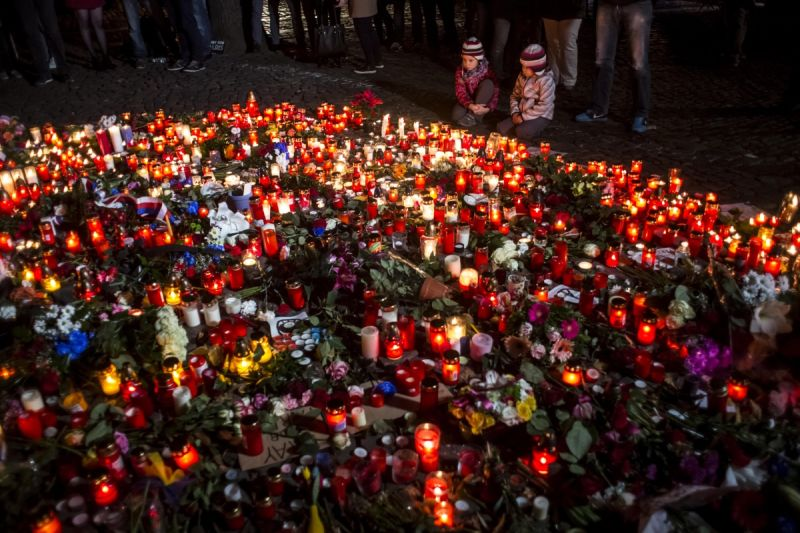 Candles and flowers at the fence of the French Embassy in Prague. Photo: Getty
