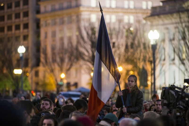 A flag is flown at a vigil in Washington D.C. Photo: Getty