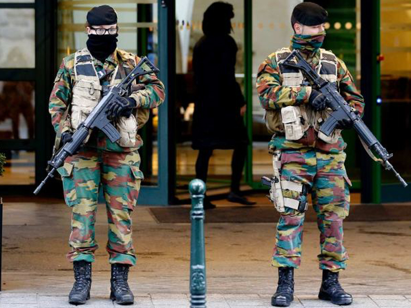 Belgian soldiers stand guard in Brussels. Photo: AAP