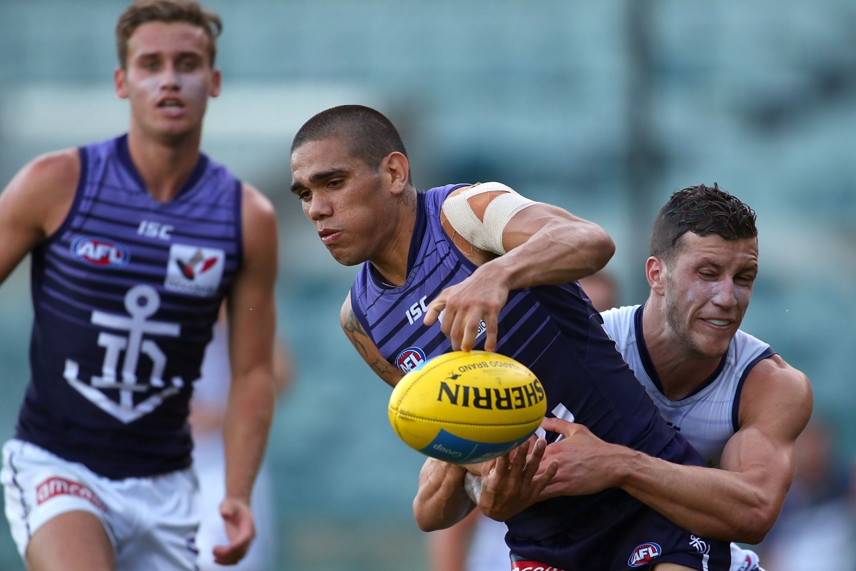 Sam Menegola gets to grips with Michael Walters at Fremantle training. Photo: Getty