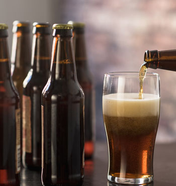 Brewing your own beer equates to about $12 per carton. Photo: Getty