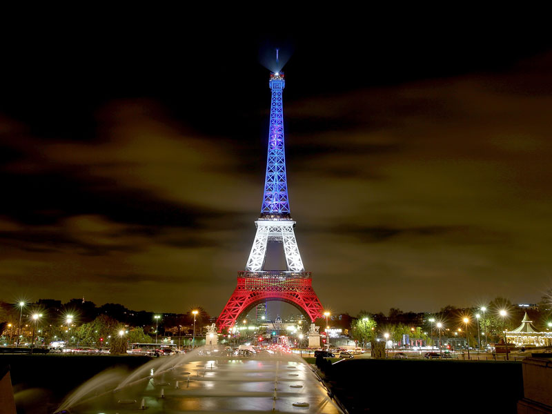 The Eiffel Tower was bathed in blue, white and red when it reopened.