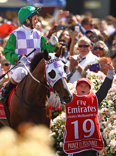 MELBOURNE, AUSTRALIA - NOVEMBER 03: Michelle Payne is congratulated by her brother Steven Payne, who has Down syndrome and works as a strapper after Michelle Payne riding Prince Of Penzance won race 7 the Emirates Melbourne Cup on Melbourne Cup Day at Flemington Racecourse on November 3, 2015 in Melbourne, Australia. (Photo by Scott Barbour/Getty Images)