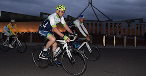Prime Minister Tony Abbott in action during an early morning bike ride with the Orica GreenEDGE cycling team outside Parliament House in Canberra, Thursday, Nov. 27, 2014. (AAP Image/Lukas Coch) NO ARCHIVING