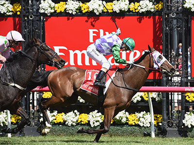 MELBOURNE, AUSTRALIA - NOVEMBER 03: Michelle Payne riding Prince of Penzance defeats Frankie Dettori riding Max Dynamite in race 7, the Emirates Melbourne Cup on Melbourne Cup Day at Flemington Racecourse on November 3, 2015 in Melbourne, Australia. (Photo by Vince Caligiuri/Getty Images)