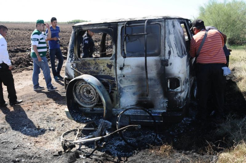 "The pair's burnt out van on a dirt road known as ""the 25"" in Sinaloa, Mexico. Photo: AAP"