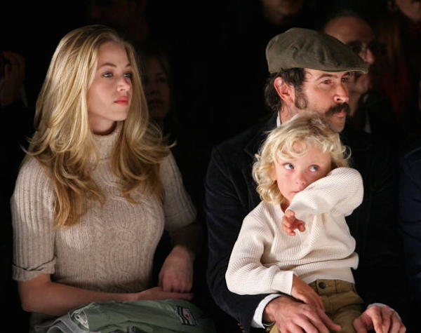 Beth Riesgraf (left) and fiancee Jason Lee with their child, Pilot Inspektor Riesgraf-Lee. Photo: Getty