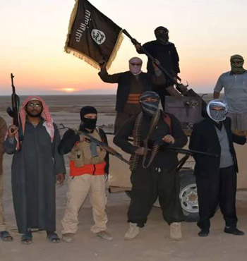 IS militants wave a flag in Iraq.