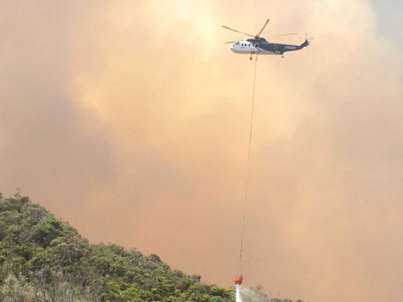 Helicopter drops water on flames Separation Creek