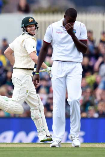 West Indies captain Jason Holder feels the pain as Adam voges cashes in. Photo: Getty