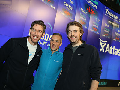 A supplied image obtained Friday, Dec.11, 2015 of the Co-Founders of Sydney technology company Atlassian Scott Farquhar (left) and Mike Cannon-Brookes (right), during the launch of their company's stock on the US Nasdaq market. Aussie tech darling Atlassian has smashed its debut on the US Nasdaq market, with its stock soaring by 32 per cent, valuing the company at $A8 billion and making its co-founders overnight billionaires. (AAP Image/Howorth) NO ARCHIVING, EDITORIAL USE ONLY