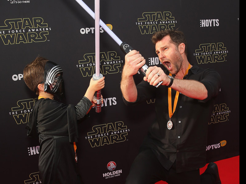 Photo: Getty</em> Singer and unofficial Jedi Master, David Campbell, 'guides' his son at the premier.