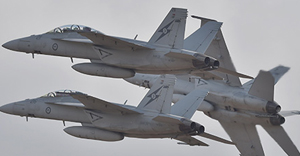 Royal Australian Air Force F-18 Hornets perform during the Australian International Airshow at the Avalon Airfield near Lara southwest of Melbourne on February 24, 2015. Some 180,000 patrons were expected through the gates over the duration of the event. AFP PHOTO / Paul CROCK (Photo credit should read PAUL CROCK/AFP/Getty Images)