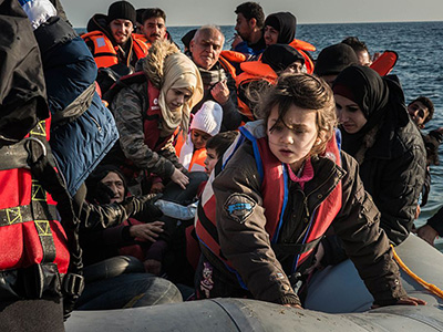 LESBOS ISLAND, GREECE - DECEMBER 25 : Refugees are seen upon their arrival on Mytilene of Lesbos Island, Greece after crossing the Aegean sea from Turkey on December 25, 2015. (Photo by Esteban Martinena/Anadolu Agency/Getty Images)