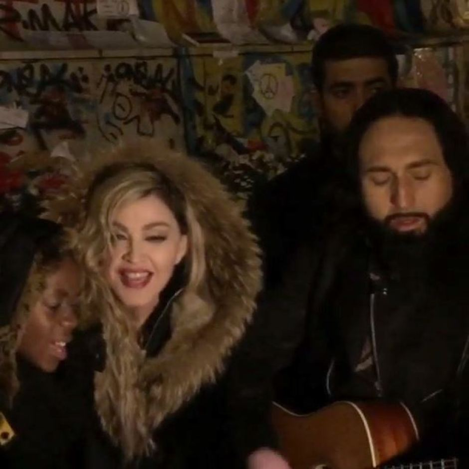 Madonna singing with son David and her guitarist. Photo: ABC