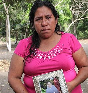 Roselia Diaz holds a picture of her dead son, Ezequiel.