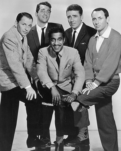 circa 1960: The members of the Rat Pack posing in a full-length studio portrait. L-R: Frank Sinatra (1915 - 1998), Dean Martin (1917 - 1995), Sammy Davis, Jr (1925 - 1990, centre), Peter Lawford (1923 - 1984), and Joey Bishop. (Photo by CBS Photo Archive/Getty Images)