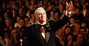 UNITED KINGDOM - SEPTEMBER 01: ROYAL ALBERT HALL Photo of Frank SINATRA, performing live onstage, waving, with audience behind. (Photo by David Redfern/Redferns)