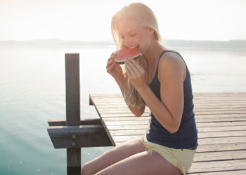 woman eating watermelon savouring