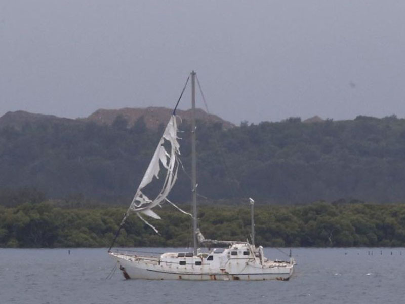 A yacht's torn sail flaps in the wind after the storm passed over Kurnell.