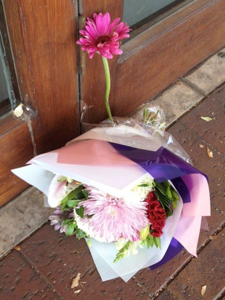 Flowers were laid outside the Datta family's Urban India restaurant on Henley Beach Road. Photo: Candice Marcus