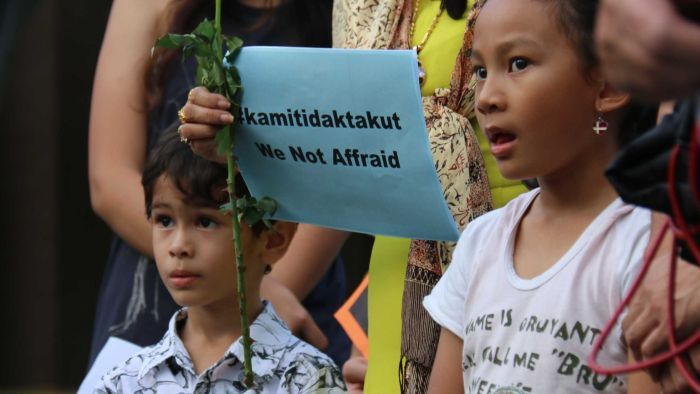 Children at the Darwin vigil for the Jakarta terror attacks in January. Photo: AAP