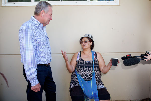 Western Australia Premier Colin Barnett talks with Yarloop resident Ada Farmer, who lost her home in the fire. Photo: AAP