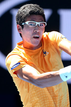 Hyeon Chung. Didn't last long, but his persimmon infused Le Coq Sportif job made an impression. Photo: Getty