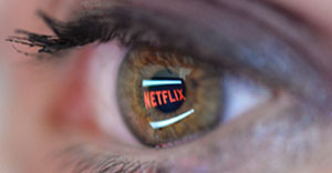 PARIS, FRANCE - SEPTEMBER 19: In this photo illustration the Netflix logo is reflected in the eye of a woman on September 19, 2014 in Paris, France. Netflix September 15 launched service in France, the first of six European countries planned in the coming months. (Photo by Pascal Le Segretain/Getty Images)