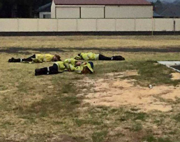Exhausted firefighters take a nap after conditions eased. Photo: ABC/Mick Reynolds
