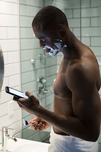 Some people have a hard time getting through a shave without checking Tinder for matches. Photo: Getty