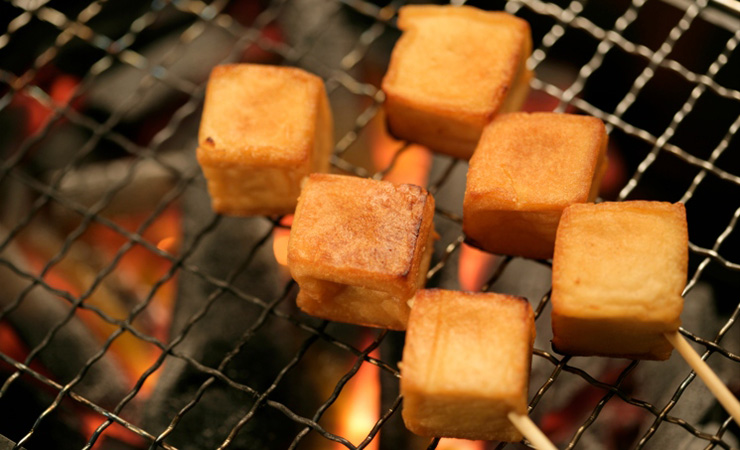 Tofu absorbs loads of flavour. Photo: Getty