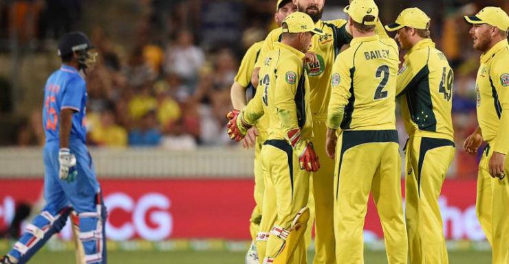 Kane Richardson celebrates a wicket as India crumbles.