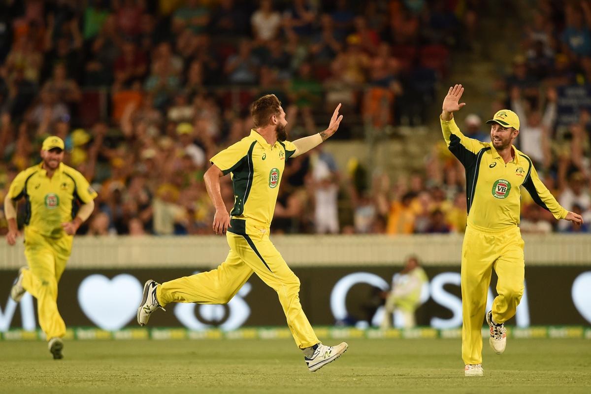 Australia's Kane Richardson celebrates his wicket of India's Ajinkya Rahane, caught by captain Steve Smith off a Richardson delivery.