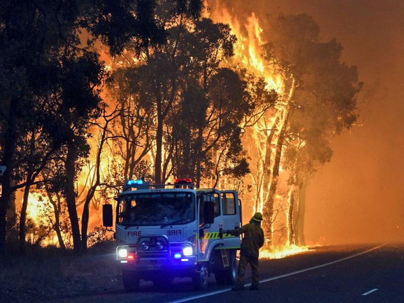 Firefighters battle a blaze in Waroona.