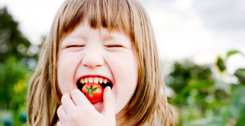 girl tomato vegetable smile happy